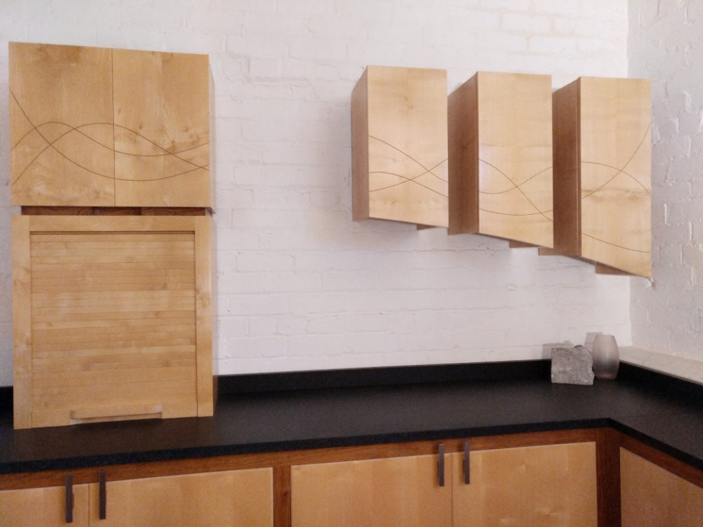 arc shaped sycamore wall cupboards